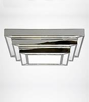 A great, handsome ceiling-hugging light fixture.  Square Stepped Deco Light, Charles Edwards Lighting