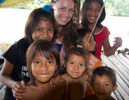 Dani Blanchette: Me and the Warao children - letting the children play with my camera.jpg