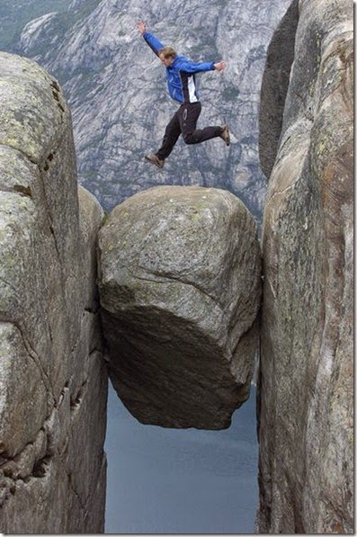 man-jumping-on-preikestolen-rock-norway-kjerag-lysefjord