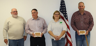 Adult Volunteer Awards - Left to right: Lean Greiner (Friend of 4-H), Terry Engelken of Federation Bank (Partner in 4-H Award), Sheila Temple (4-H Volunteer of the Year), Jim Schneider 4-H Alumni Award.  Photo Courtesy:  Washington County Extension.