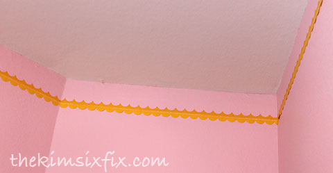Taping scallopped border