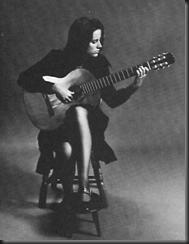 posicion correcta guitarra clasica postura mujer