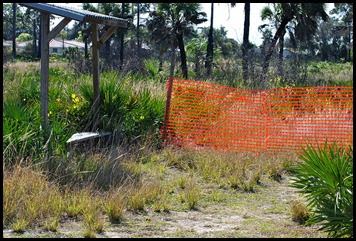 03e0 - Eagle Walk - Bench and Orange mesh barrier