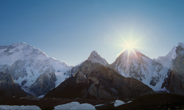 Daybreak over Gasherbrum IV on the Baltoro glacier in the Karakoram range of the Himalayas. Ed Darack / Corbis