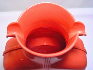 salmon pink Shel Glo double spout pitcher with stopper interior