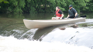 2 guys who are not members of the HRCKC demonstrating the double gunnel grab going over the dam below Ramapo Reservation