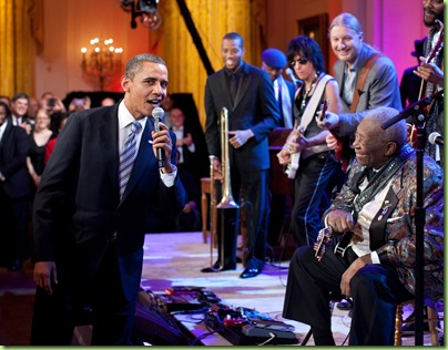 "President Obama joins in singing ""Sweet Home Chicago"" during the ""In Performance at the White House: Red, White and Blues"" concert in the East Room of the White House, Feb. 21, 2012. Participants include, from left: Troy ""Trombone Shorty"" Andrews, Jeff Beck, Derek Trucks,  B.B. King, and Gary Clark, Jr.  (Official White House Photo by Pete Souza)