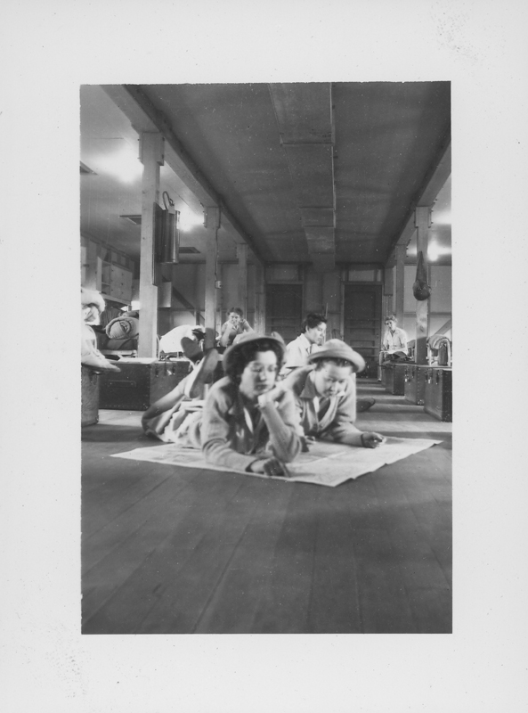 "Esther Herbert lies on the floor in the barracks at ""San Berdu"" (San Bernardino military base). September 1943 - April 1944."