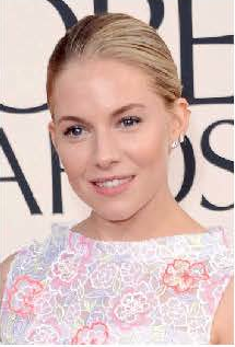 To complement Sienna Miller's airy frock, makeup artist Pati Dubroff went with a natural, effortless look. Navy blue eyeliner, layered with Chanel's Intense Eye Penil in Graphite, defined her eyes. Light, fluid foundation and Soleil Tan de Chanel Bronzing Makeup base helped impart a dewy, sunny glow. Photo courtesy of Chanel.