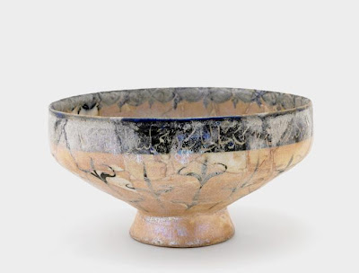 Footed bowl | Origin:  Kashan,  Iran | Period: 12th century  Saljuq period | Details:  Not Available | Type: Earthenware painted with glaze | Size: H: 10.6  W: 20.2  cm | Museum Code: S1997.111 | Photograph and description taken from Freer and the Sackler (Smithsonian) Museums.