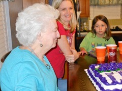 mom summer trinity  blow out candles