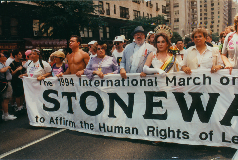 Marchers carrying Stonewall banner at Stonewall 25 parade. June 26, 1994.