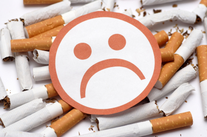 of cigarettes smoking jpg stop smoking sad face over broken cigarettes