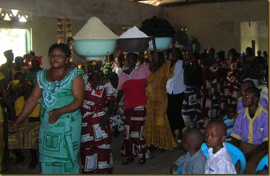 At this church in Kananga, members of one of the small groups pooled their resources to give gifts of food and house-hold goods to the pastor. They were an impressive procession! The corn and cassava flour comes first, then charcoal, then greens and oil.