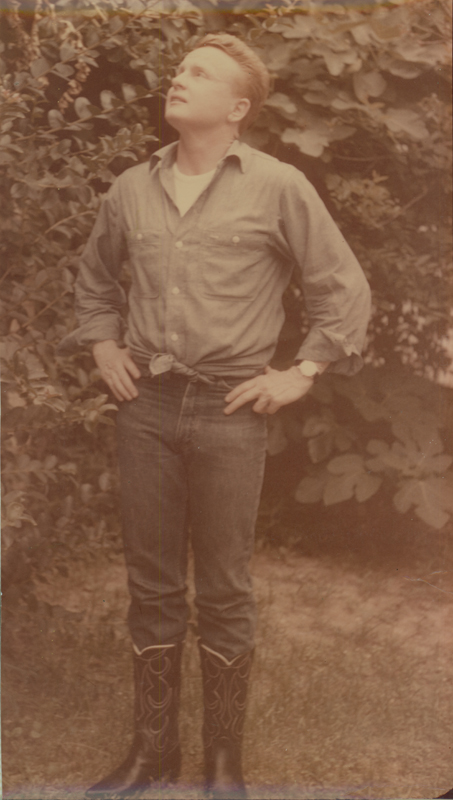 Reed Erickson outside in casual jeans and boots. Undated.