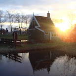 the sun is setting at the zaanse schans in zaandam in Zaandam, Noord Holland, Netherlands