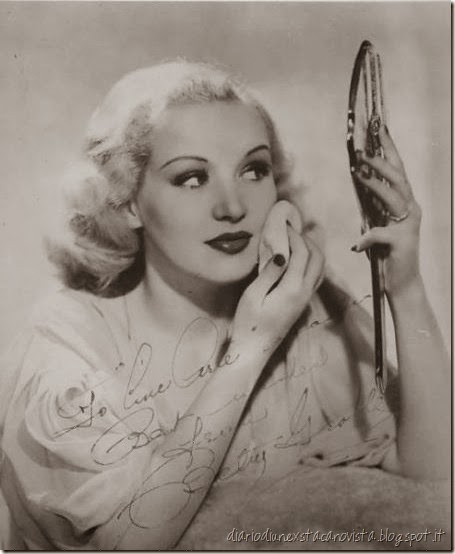 Betty Grable applying the finishing touches to her make-up