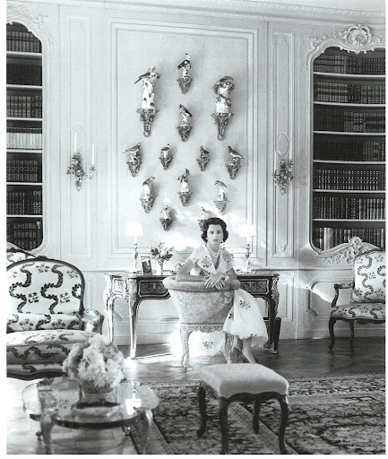 Jayne Wrightsman in her library in Palm Beach. The giltwood brackets mounted on the wall and topped with Meissen porcelain birds reminds me of something and I can't quite put my finger on it...