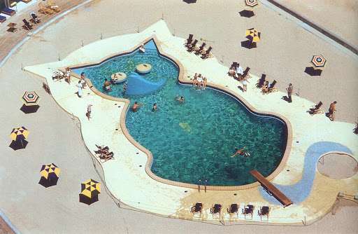 Pools come in all sorts of clever shapes, but this is the most whimsical I've ever seen. Fontainbleau Hotel, Miami, Florida, 1955. (Poolside with Slim Aarons, Abrams)