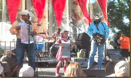 crawfish festival stage with little girl