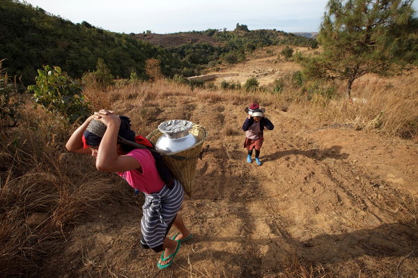 Women bringing back water from a community tap in Cherrapunji, in northeastern India. Photo: Kuni Takahashi / The New York Times