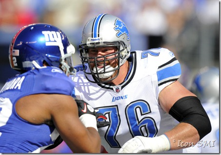 Detroit Lions left tackle Jeff Backus blocks New York Giants DE Osi Umenyiora.