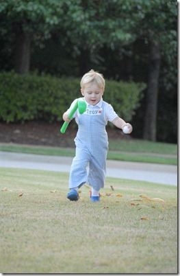 troy running with golf club