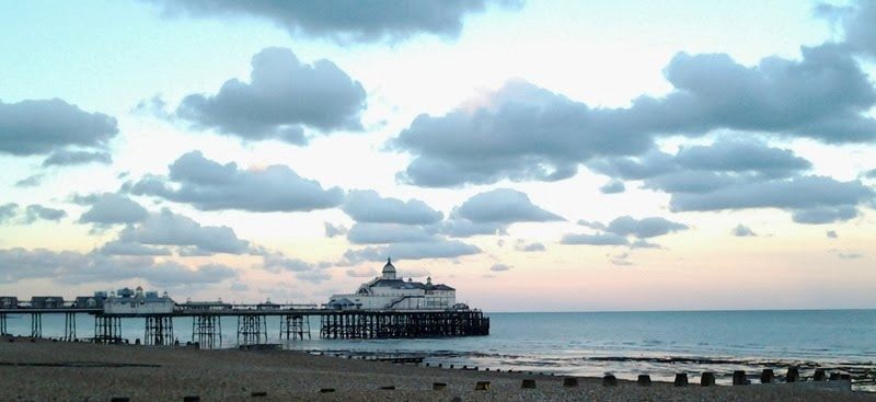 Fluffy clouds over Eastbourne pier