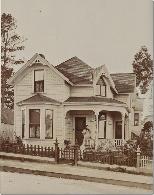 Bertha in front of house c 1895