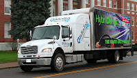BAE Systems' HybriDrive brand parallel hybrid electric powertrain for trucks is being tested on a Freightliner M2 by Bates Troy Healthcare Linens of Binghamton, N.Y.