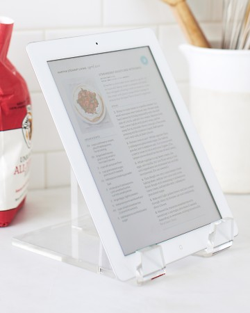 Try an almost-invisible, inexpensive acrylic plate stand to prop up your tablet on your desk or kitchen counter, keeping it easily accessible with minimal fuss.