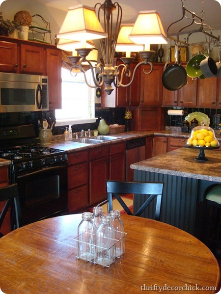 black backsplash, wood cabinets