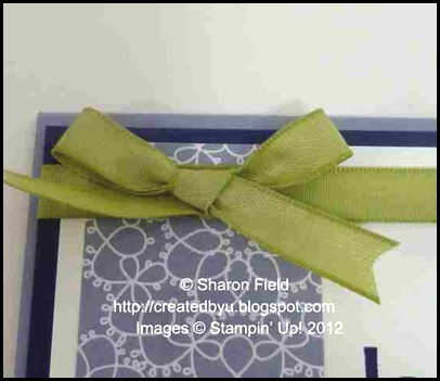 bunny ear bow with notched ends lies flat on card surface
