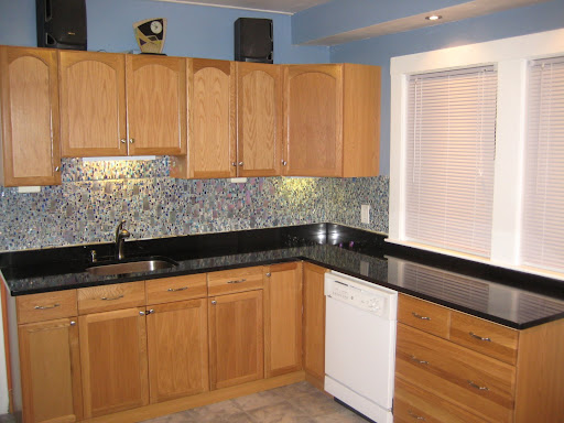 Black Granite Countertops With Oak Cabinets : Black granite countertops with oak cabinets