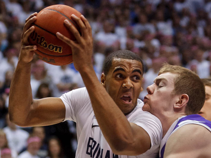 BYU forward Brandon Davies (0) drives on Portland forward Ryan Nicholas (32). BYU vs. Portland, college basketball Saturday, February 25, 2012 in Provo, Utah.