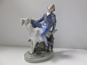 Royal Copenhagen of Denmark numbered Boy Riding Goat