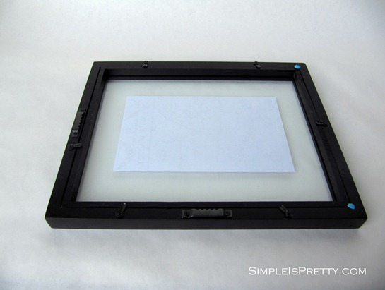 Sticky tac on picture frame