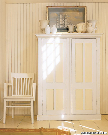 This cabinet is painted with varying shades of white and ivory to create contouring.