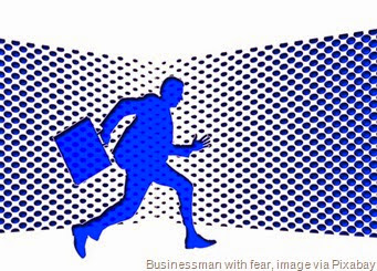 businessman-running-scared