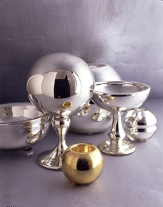 Attractive rounded forms include a gazing ball, compote, small match striker, large and small rose bowls, and a bowl with clear glass feet.