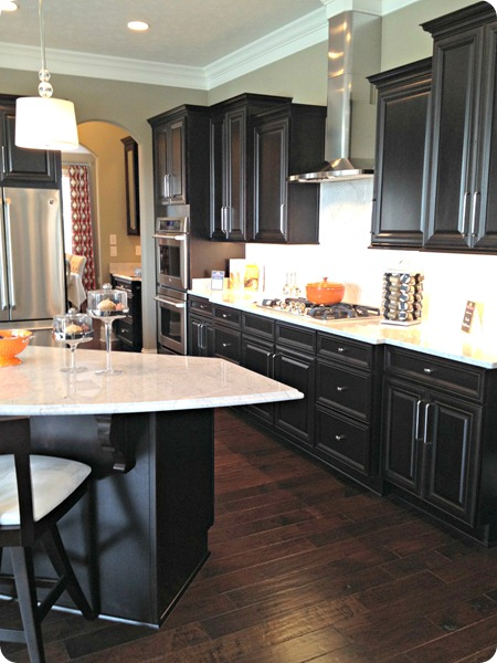 black cabinets light counters
