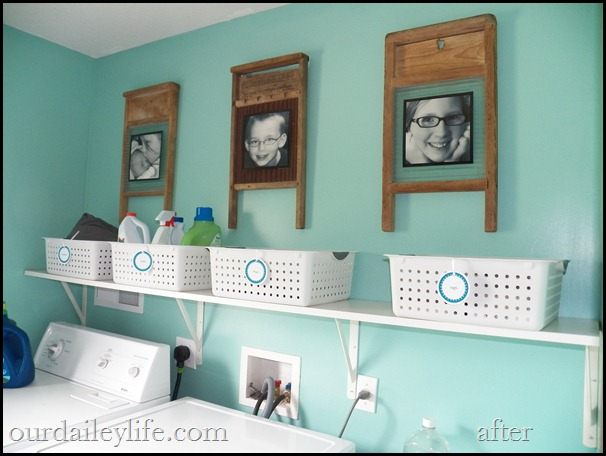 laundry room, white baskets, teal walls, vintage washboards as picture frames