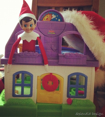 Elf on the Shelf hiding in a doll house