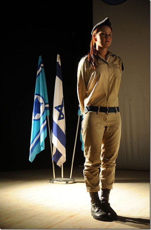 """""""A Deserved Decoration"""", 2012. IDF medic Anastasia Begdlov was a passenger on a civilian bus on the Israel-Egypt border last August when terrorists opened fire on it. Begdlov treated injured passengers immediately, improvising with whatever supplies she could reach. She used her bra as a tourniquet on a severely wounded man's knee, saving his life. Today, the IDF rewarded her with a military decoration. Begdlov is currently a cadet in officers' course."""