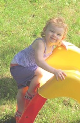 2012 Memorial Day Bella on her slide9