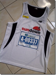 The irony of it, running KL Marathon in a Sundown Singapore running vest! :)