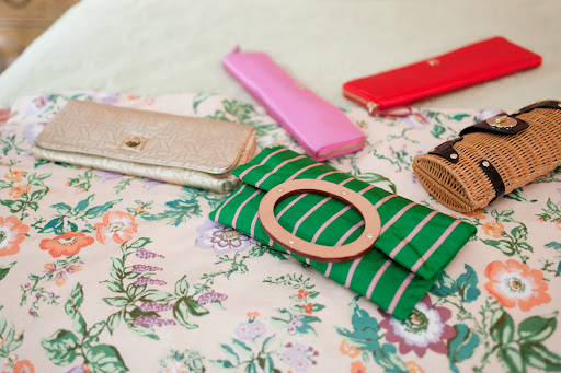 all of the bridesmaids carried kate spade clutches - not down the aisle, but for the rest of the day.
