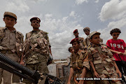 Real soldiers and toy soldiers. Friday prayer on 60 Meter Rd, Sana&#039;a, Yemen        