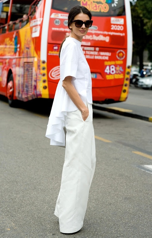 STREET-STYLE-WHITE-PEPLUM-AND-FRILLS-MILAN-FASHION-WEEK-PEPLUM-BACK-TOP-WIDE-LEG-WHITE-PANT-VIA-VOGUE-UK-Leila-Yavari