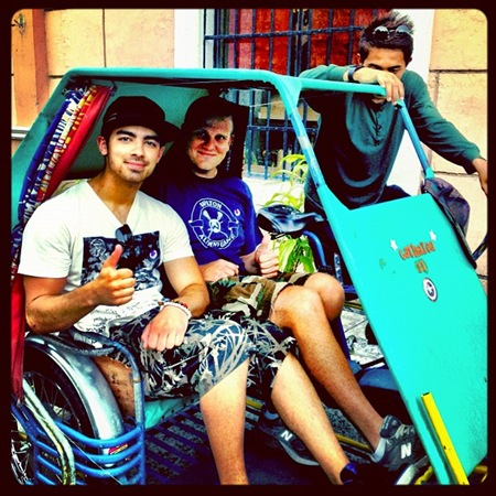 Joe Jonas and Brahms in pedicab at Fort Santiago
